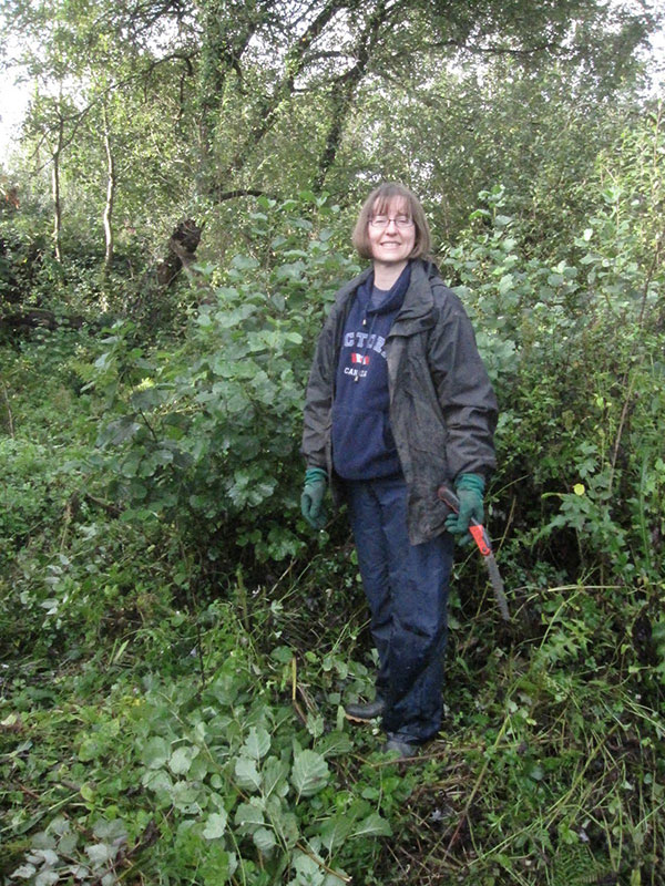 Sandra during reed bed restoration, Brixham, Devon