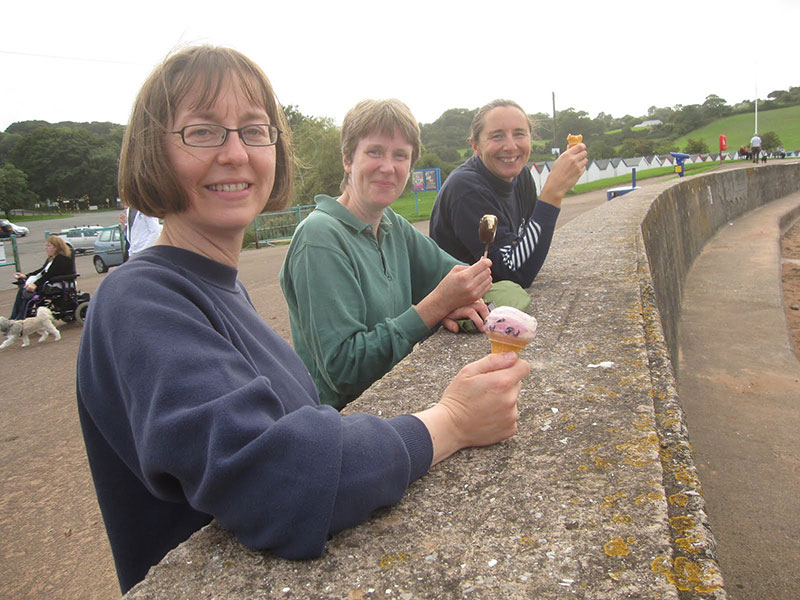 Enjoying a well earned ice-cream after reed bed restoration, Brixham, Devon