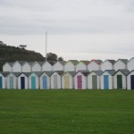 The colourful beach huts at Brixham.